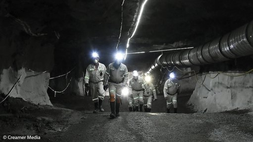 An image of miners underground