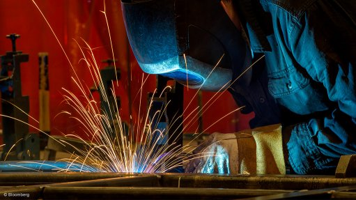 An image of a person welding
