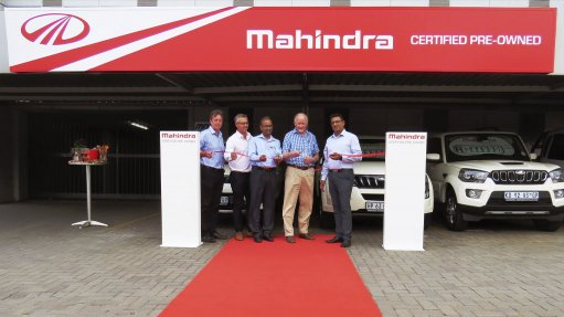 Image of the opening of a Mahindra pre-owned vehicle franchise