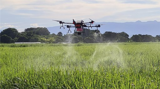 Image of a DJI T30 Agras spraying drone