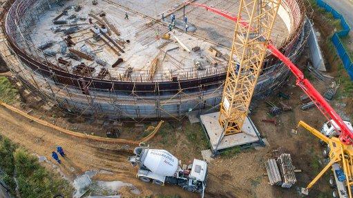 A photo of a concrete reservoir under construction