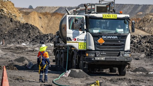 An image of a mine worker using Enaex's Mine I-Truck to delivers down-the-hole explosives