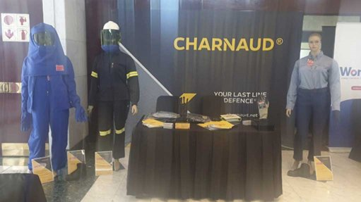 A Charnaud stand at an event with Hazmat suits, Reflective clothing, corporate clothing, gloves, goggles and boots