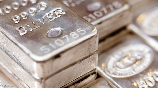 Image shows stacked silver bars