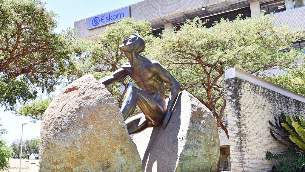 Photo of Eskom's rock-man statue at Megawatt Park