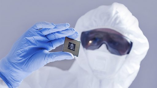 Image of a man holding a computer chip