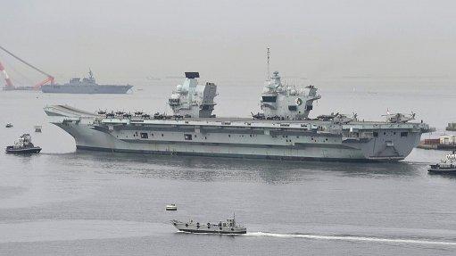 A photo of the HMS Queen Elizabeth departing Yokosuka, Japan, in September 2021