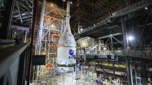 A photo of the Orion spacecraft mounted on top of the SLS in the VAB