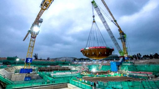 A photo of the ACP100 reactor containment vessel bottom head being craned into position