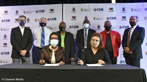 An image of members signing an agreement on the terms of reference for the parties to collaborate on modernising the South African mining industry