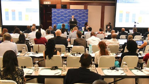A photo of Eskom CFO Calib Cassim presenting its case at a previous tariff hearing