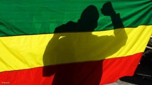 Ethiopia says foes surrendering, Tigray forces report battle win