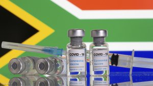 Covid-19 vaccines against a South African flag