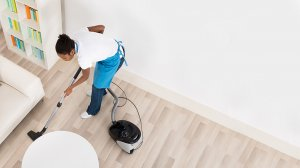 image of helper cleaning the house